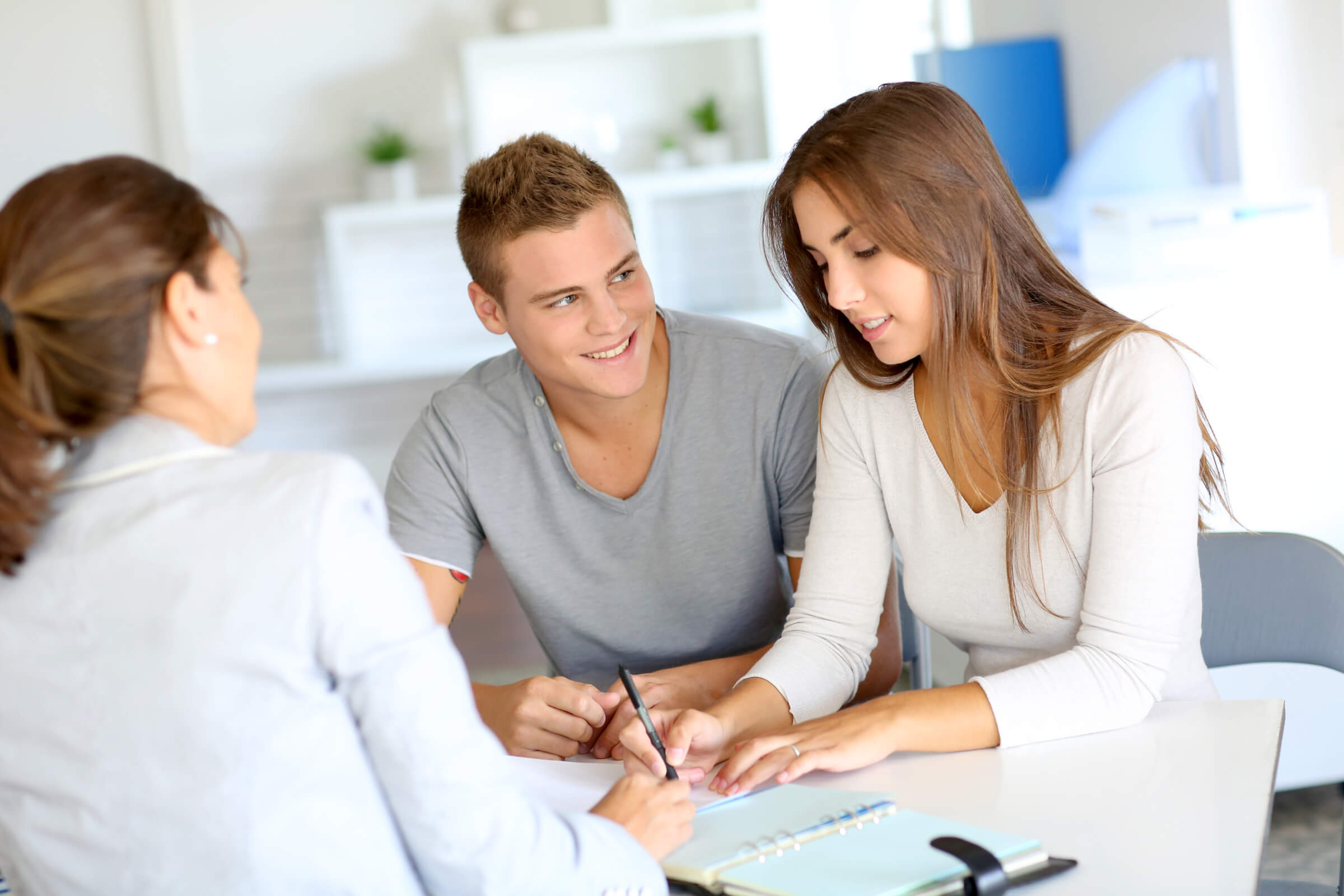 A couple signing a property contract